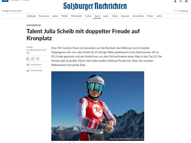 Bild zeigt die Österreicherin Julia Scheib vor einer Bergkette stehend
